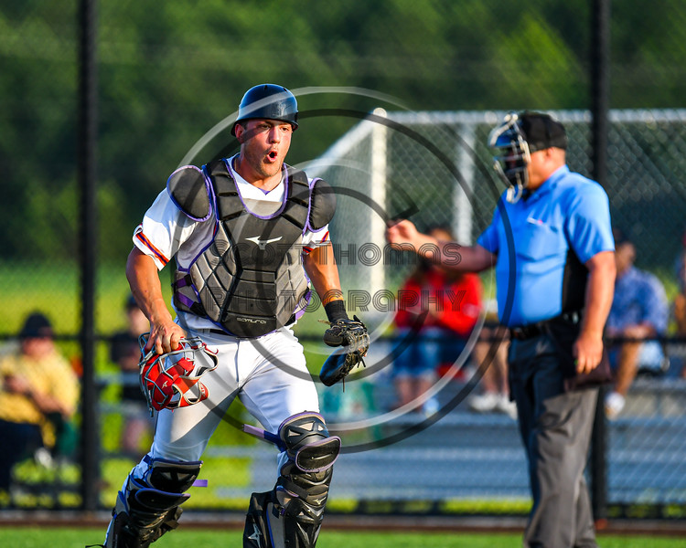 Cortland Crush Catcher Dylan Nolan (14) reacts after the last out of the inning against the Syracuse Salt Cats in New York Collegiate Baseball League playoff action at Gutchess Lumber Sports Complex in Cortland, New York on Thursday, July 24, 2019. Cortland won 1-0 in extra innings.