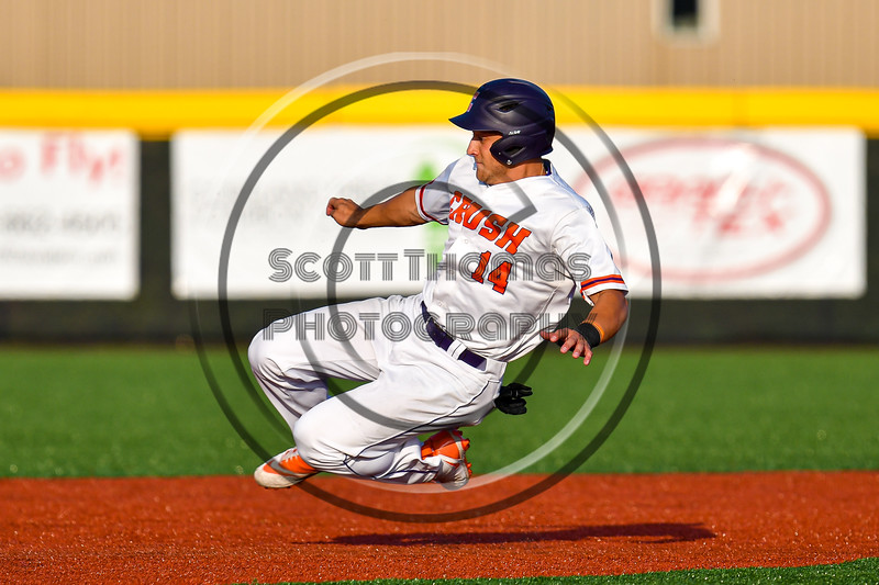 Cortland Crush Dylan Nolan (14) slides into Second Base against the Syracuse Salt Cats in New York Collegiate Baseball League playoff action at Gutchess Lumber Sports Complex in Cortland, New York on Thursday, July 24, 2019. Cortland won 1-0 in extra innings.