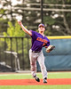 Cortland Crush Stephen Bennett (30) throwing out the Syracuse Salt Cats runner at First Base in New York Collegiate Baseball League playoff action at OCC Turf Field in Syracuse, New York on Thursday, July 25, 2019. Cortland won 3-1.