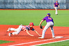 Cortland Crush Alex Flock (10) tags the Syracuse Salt Cats base runner out at First Base in New York Collegiate Baseball League playoff action at OCC Turf Field in Syracuse, New York on Thursday, July 25, 2019. Cortland won 3-1.