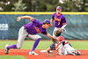 Cortland Crush Jack Lynch (2) tags the Syracuse Salt Cats runner out at Second Base in New York Collegiate Baseball League playoff action at OCC Turf Field in Syracuse, New York on Thursday, July 25, 2019. Cortland won 3-1.