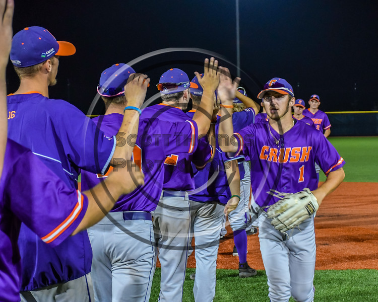Cortland Crush Nicholas Pastore (1) celebrating a New York Collegiate Baseball League playoff game against the Syracuse Salt Cats at OCC Turf Field in Syracuse, New York on Thursday, July 25, 2019. Cortland won 3-1.