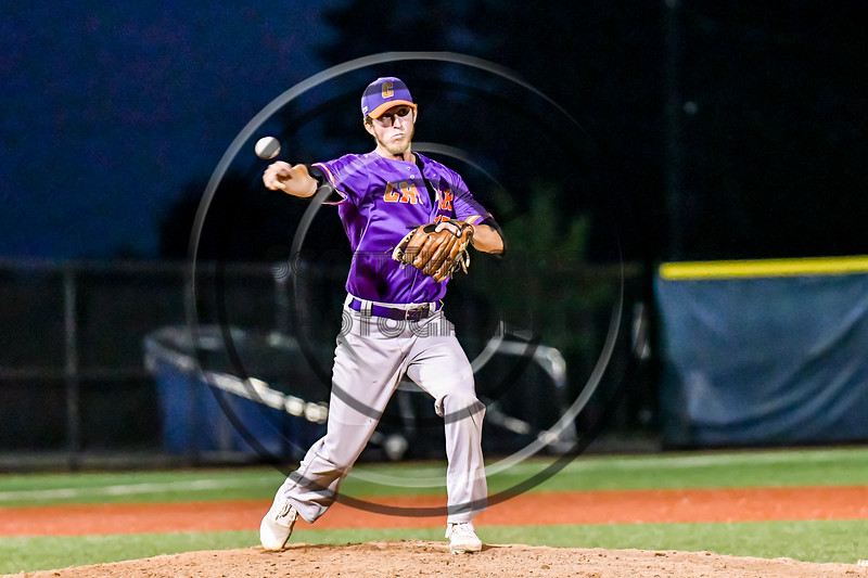 Cortland Crush Jimmy Tatum (17) checks and then throws the ball to First Base against the Syracuse Salt Cats in New York Collegiate Baseball League playoff action at OCC Turf Field in Syracuse, New York on Thursday, July 25, 2019. Cortland won 3-1.