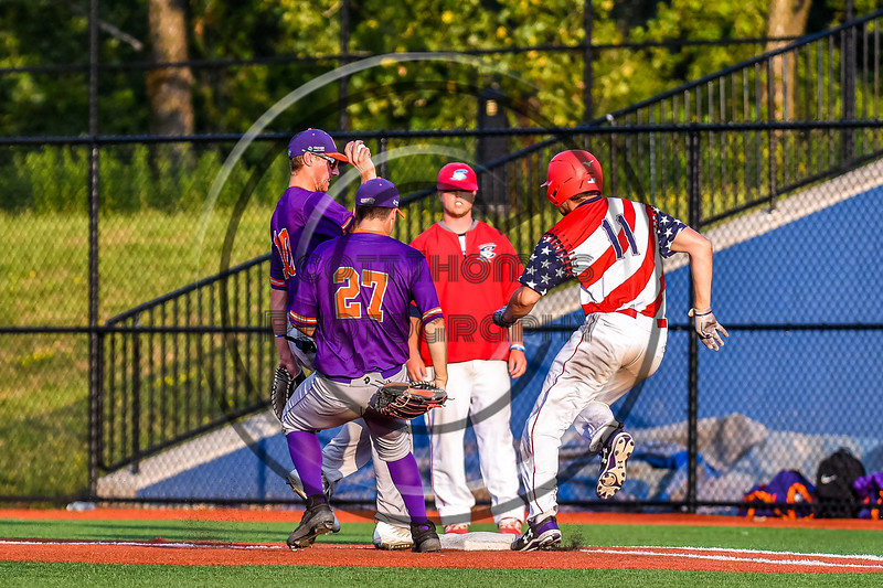 Cortland Crush Alex Flock (10) gets to First Base to force an out against Syracuse Salt Cats Jack Anderson (11) in New York Collegiate Baseball League playoff action at OCC Turf Field in Syracuse, New York on Thursday, July 25, 2019. Cortland won 3-1.