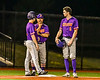 Cortland Crush Head Coach Bill McConnell (6) talking with base runners Jack Lynch (2) and Anthony Cieszko (3) durign a pitching change by the Syracuse Salt Cats in New York Collegiate Baseball League playoff action at OCC Turf Field in Syracuse, New York on Thursday, July 25, 2019. Cortland won 3-1.
