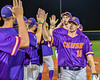 Cortland Crush Alex Flock (10) celebrating a New York Collegiate Baseball League playoff game against the Syracuse Salt Cats at OCC Turf Field in Syracuse, New York on Thursday, July 25, 2019. Cortland won 3-1.