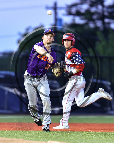 Cortland Crush Stephen Bennett (30) fields and throws the Syracuse Salt Cats runner out at First Base in New York Collegiate Baseball League playoff action at OCC Turf Field in Syracuse, New York on Thursday, July 25, 2019. Cortland won 3-1.