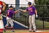 Cortland Crush Head Coach Bill McConnell (6) congratulates Garrett Callghan (15) on his Triple against the Syracuse Salt Cats in New York Collegiate Baseball League playoff action at OCC Turf Field in Syracuse, New York on Thursday, July 25, 2019. Cortland won 3-1.