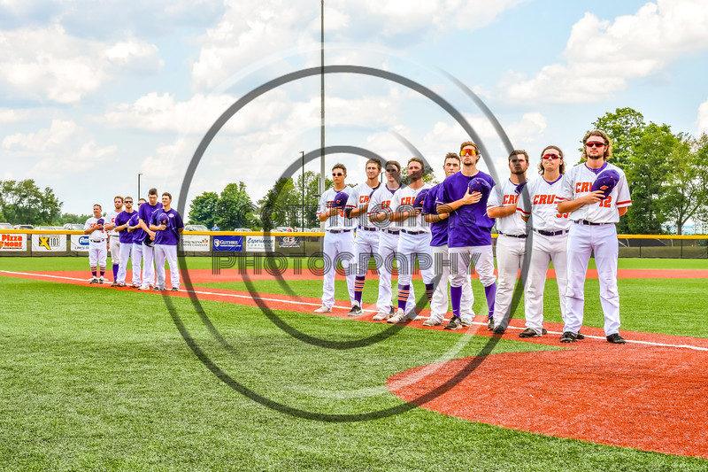 Cortland Crush players stand for the National Anthem before playing in the New York Collegiate Baseball League Championship Series at Gutchess Lumber Sports Complex in Cortland, New York on Saturday, July 27, 2019.