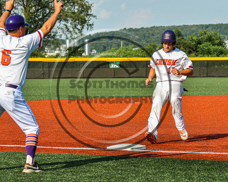 Cortland Crush Dylan Nolan (14) is held at Thrid Base against the Niagara Power in New York Collegiate Baseball League playoff action at Gutchess Lumber Sports Complex in Cortland, New York on Saturday, July 27, 2019. Niagara won 10-6.