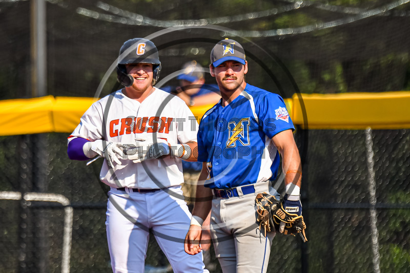 Cortland Crush Hayden Houts (5) and Niagara Power Frank Lucska (25) at First Base in New York Collegiate Baseball League playoff action at Gutchess Lumber Sports Complex in Cortland, New York on Saturday, July 27, 2019. Niagara won 10-6.