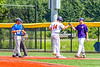 Cortland Crush Dylan Nolan (14) gets a fist bump for reaching First Base against the Niagara Power in New York Collegiate Baseball League playoff action at Gutchess Lumber Sports Complex in Cortland, New York on Saturday, July 27, 2019. Niagara won 10-6.