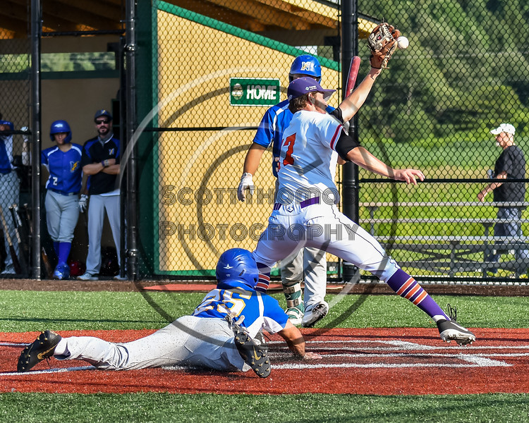 Niagara Power Joseph Barberio (26) slides into Home Plate to score a run against Cortland Crush Jimmy Tatum (17) in New York Collegiate Baseball League playoff action at Gutchess Lumber Sports Complex in Cortland, New York on Saturday, July 27, 2019. Niagara won 10-6.