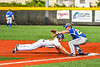 Cortland CrushStephen Bennett (30) dives back to First Base before the ball arrives against Niagara Power Frank Lucska (25) in New York Collegiate Baseball League playoff action at Gutchess Lumber Sports Complex in Cortland, New York on Saturday, July 27, 2019. Niagara won 10-6.