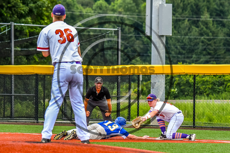 Cortland Crush Pitcher Jared Strait (36) and Hayden Houts (5) keep the Niagara Power runner at First Base in New York Collegiate Baseball League playoff action at Gutchess Lumber Sports Complex in Cortland, New York on Saturday, July 27, 2019. Niagara won 10-6.