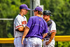 Cortland Crush Pitching Coach Ryan Stevens (13) talks with Pitcher Jared Strait (36) and Catcher Dylan Nolan (14) on the mound against the Niagara Power in New York Collegiate Baseball League playoff action at Gutchess Lumber Sports Complex in Cortland, New York on Saturday, July 27, 2019. Niagara won 10-6.