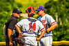 Cortland Crush Dylan Nolan (14) and Ryan Reicoff (38) talking with the Umpire during a timeout against the Niagara Power in New York Collegiate Baseball League playoff action at Gutchess Lumber Sports Complex in Cortland, New York on Saturday, July 27, 2019. Niagara won 10-6.