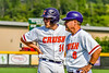 Cortland Crush Dylan Nolan (14) and Head Coach Bill McConnell (6) conferencing at Third Base against the Niagara Power in New York Collegiate Baseball League playoff action at Gutchess Lumber Sports Complex in Cortland, New York on Saturday, July 27, 2019. Niagara won 10-6.