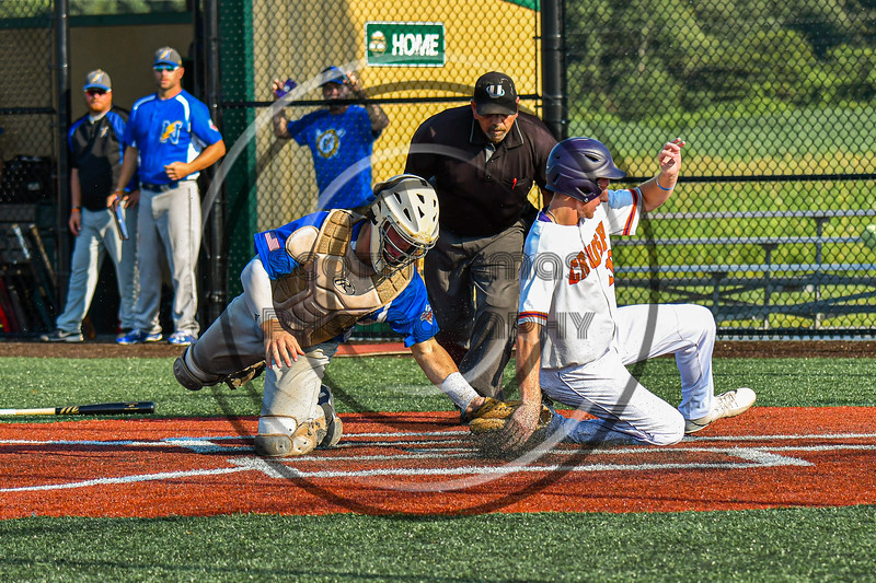 Cortland Crush Alex Flock (10) beats the tag by Niagara Power Catcher Jack Rubenstein (10) to score a run in New York Collegiate Baseball League playoff action at Gutchess Lumber Sports Complex in Cortland, New York on Saturday, July 27, 2019. Niagara won 10-6.