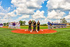 Umpires and players of the Cortland Crush and Niagara Power stand for the National Anthem before playing in the New York Collegiate Baseball League Championship Series at Gutchess Lumber Sports Complex in Cortland, New York on Saturday, July 27, 2019.