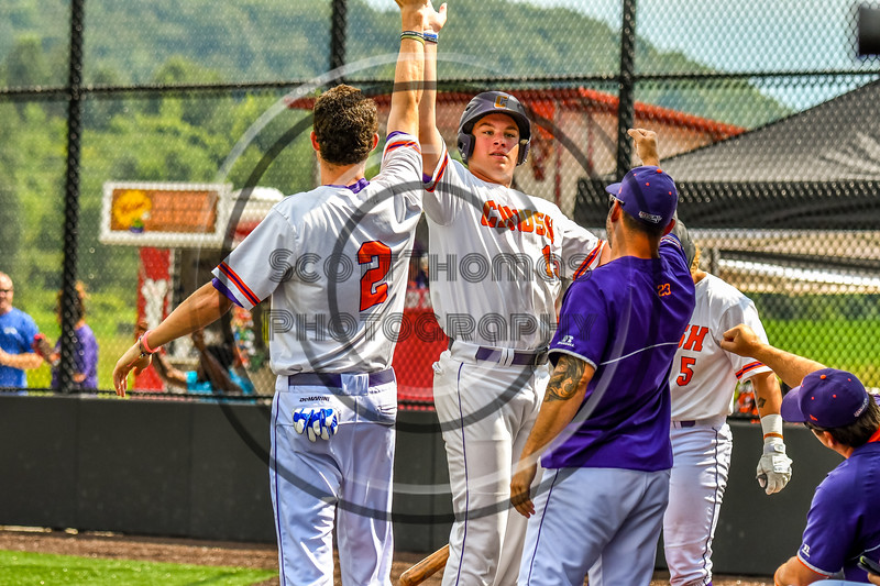 Cortland Crush Jack Lynch (2) gives Garrett Callghan (15) a High Five for his run against the Niagara Power in New York Collegiate Baseball League playoff action at Gutchess Lumber Sports Complex in Cortland, New York on Saturday, July 27, 2019. Niagara won 10-6.