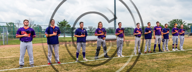 Cortland Crush Bull Pen Pitchers and Catchers standing for the National Anthem before playing the Niagara Power in a New York Collegiate Baseball League Championship game at Sal Maglie Stadium in Niagara Falls, New York on Sunday, July 28, 2019.