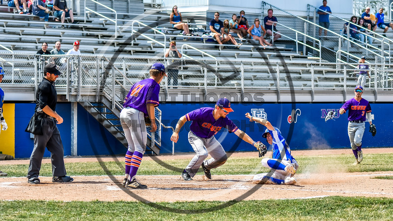 Cortland Crush Stephen Bennett (30) tags out the Niagara Power runner at Home Plate in New York Collegiate Baseball League playoff action at Sal Maglie Stadium in Niagara Falls, New York on Sunday, July 28, 2019. Niagara won 12-6.