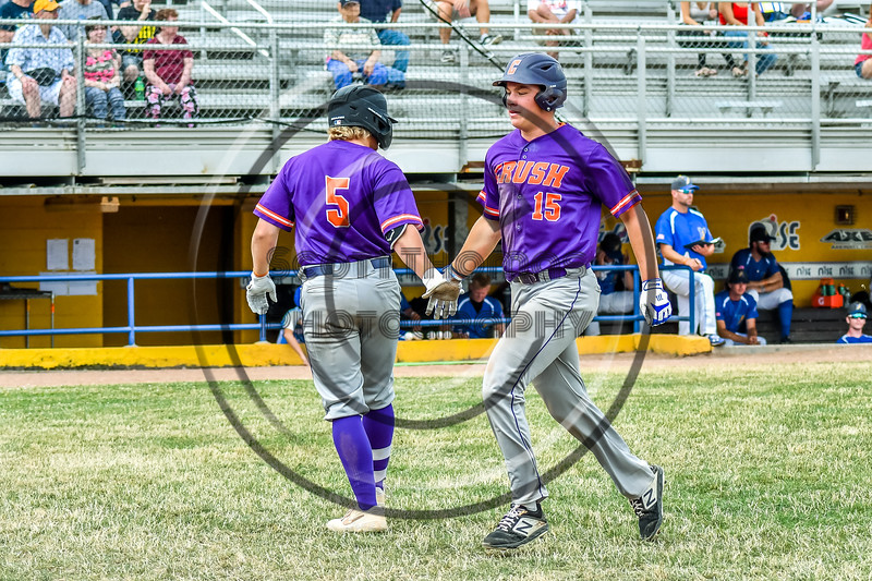 Cortland Crush Garrett Callghan (15) gets congratulated by Hayden Houts (5) for his run against the Niagara Power in New York Collegiate Baseball League playoff action at Sal Maglie Stadium in Niagara Falls, New York on Sunday, July 28, 2019. Niagara won 12-6.