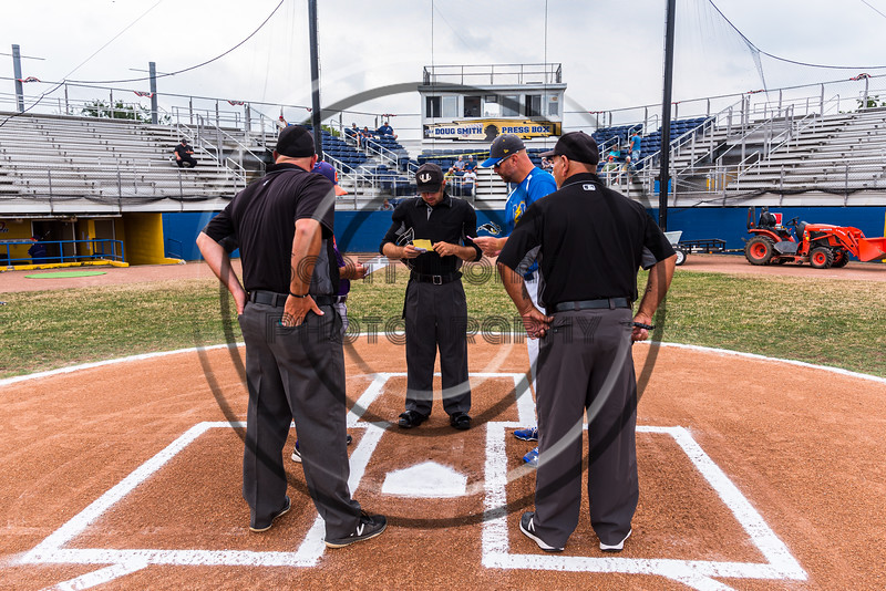 Cortland Crush Head Coach Bill McConnell (6) and Niagara Power Head Coach Arthur Stenberg go over rosters with the Umpire team before a New York Collegiate Baseball League Championship game at Sal Maglie Stadium in Niagara Falls, New York on Sunday, July 28, 2019.