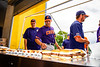 Cortland Crush players and coaches grab a meal before playing the Niagara Power in a New York Collegiate Baseball League Championship game at Sal Maglie Stadium in Niagara Falls, New York on Sunday, July 28, 2019.