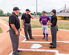 Cortland Crush Head Coach Bill McConnell (6) talking with the Umpire team before playing the Niagara Power in a New York Collegiate Baseball League Championship game at Sal Maglie Stadium in Niagara Falls, New York on Sunday, July 28, 2019.