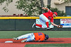 Cortland Crush Corey Stofko (15) slides safely into Second Base as the Albany Athletics player jumps to get the ball in New York Collegiate Baseball League action at Gutchess Lumber Sports Complex in Cortland, New York on Sunday, June 6, 2021.