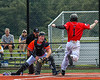 Cortland Crush Nicholas Pastore (1) gets tagged out at Home by the Albany Athletics Catcher in New York Collegiate Baseball League action at Gutchess Lumber Sports Complex in Cortland, New York on Sunday, June 6, 2021.