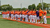 Cortland Crush players stand along the Third Base line for the National Anthem before playing the Albany Athletics in a New York Collegiate Baseball League game at Gutchess Lumber Sports Complex in Cortland, New York on Sunday, June 6, 2021.