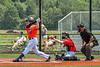 Cortland Crush Matthew Ward (20) swings and misses the ball against the Albany Athletics in New York Collegiate Baseball League action at Gutchess Lumber Sports Complex in Cortland, New York on Sunday, June 6, 2021.