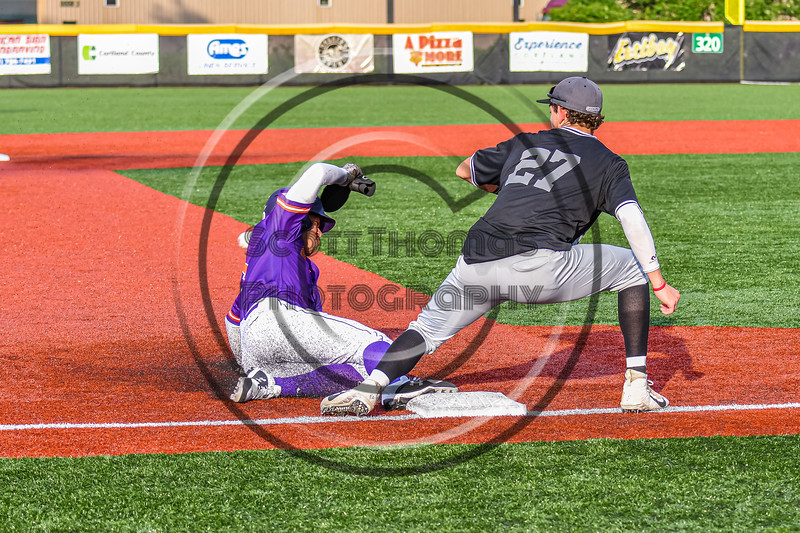 Cortland Crush Javier Rosa (3) sliding into Third Base against Sherrill Silversmiths Zachary Silfies (27) in New York Collegiate Baseball League action at Gutchess Lumber Sports Complex in Cortland, New York on Monday, June 7, 2021. Cortland won 10-2.