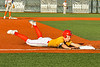 Syracuse Spartans Jordan Dickson (6) slides into Third Base against the Cortland Crush in New York Collegiate Baseball League action at OCC Turf Field in Syracuse, New York on Wednesday, June 9, 2021. Spartans won 7-5.
