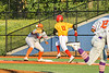 Cortland Crush First Baseman Alexis Castillo (26) about to catch the ball as Syracuse Spartans Patrick May (11) trys to beat it in New York Collegiate Baseball League action at OCC Turf Field in Syracuse, New York on Wednesday, June 9, 2021. Spartans won 7-5.