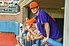 Cortland Crush players in the dugout during a New York Collegiate Baseball League game at OCC Turf Field in Syracuse, New York on Wednesday, June 9, 2021.