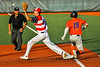"""Cortland Crush Brandon """"Buzz"""" Shirley (18) beats the throw at First Base against the Syracuse Salt Cats in New York Collegiate Baseball League action at OCC Turf Field in Syracuse, New York on Monday, June 14, 2021. Game ended in a 2-2 tie."""