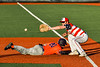 Cortland Crush Matthew Ward (20) is safe at First Base against the Syracuse Salt Cats in New York Collegiate Baseball League action at OCC Turf Field in Syracuse, New York on Monday, June 14, 2021. Game ended in a 2-2 tie.