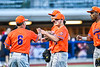 Cortland Crush Pitcher Jake Lombardi (41) is greeted by Manager Bill McConnell at the end of an inning against the Syracuse Salt Cats in New York Collegiate Baseball League action at OCC Turf Field in Syracuse, New York on Monday, June 14, 2021. Game ended in a 2-2 tie.