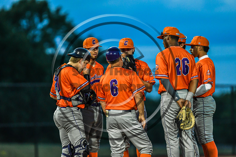 Cortland Crush Manager Bill McConnell visits the mound to talk with his players against the Syracuse Salt Cats in New York Collegiate Baseball League action at OCC Turf Field in Syracuse, New York on Monday, June 14, 2021. Game ended in a 2-2 tie.