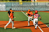 Cortland Crush Luis Rivera (37) and Alexis Castillo (26) complete the force out at First Base against Syracuse Salt Cats James Coyne (23) in New York Collegiate Baseball League action at OCC Turf Field in Syracuse, New York on Monday, June 14, 2021. Game ended in a 2-2 tie.