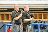 Umpires standing for the National Anthem before the Cortland Crush played the Syracuse Salt Cats in a New York Collegiate Baseball League game at OCC Turf Field in Syracuse, New York on Monday, June 14, 2021.