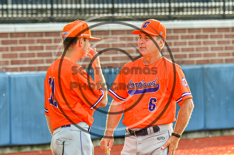 Cortland Crush Manager Bill McConnell and Assistant Coach Colin Dower (11) in a discussion before their team played the Syracuse Salt Cats in a New York Collegiate Baseball League game at OCC Turf Field in Syracuse, New York on Monday, June 14, 2021.