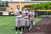Sherrill Silversmiths players and coaches standing for the National Anthem before a New York Collegiate Baseball League game at Gutchess Lumber Sports Complex in Cortland, New York on Friday, June 18, 2021.
