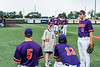 Cortland Crush players Tyler Beard (21), Zach Marriott (5) and Rob Ciulla (13) hanging out with a friend before playing the Sherrill Silversmiths in New York Collegiate Baseball League game at Gutchess Lumber Sports Complex in Cortland, New York on Friday, June 18, 2021.