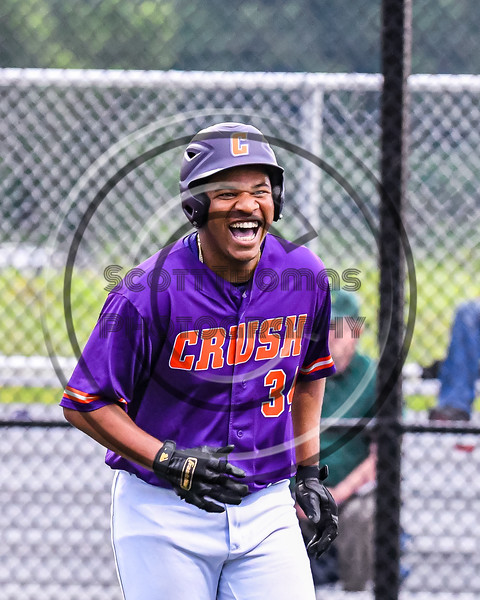 Cortland Crush Lawrence Hamilton (34) celebrates scoring a run after three fielding errors by the Sherrill Silversmiths in New York Collegiate Baseball League action at Gutchess Lumber Sports Complex in Cortland, New York on Friday, June 18, 2021. Cortland won 15-5.