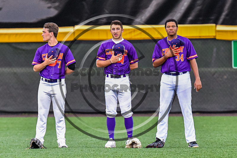 Cortland Crush players Jason Boule (7), Nicholas Pastore (1) and Lawrence Hamilton (34) standing for the National Anthem before playing the Sherrill Silversmiths in a New York Collegiate Baseball League game at Gutchess Lumber Sports Complex in Cortland, New York on Friday, June 18, 2021.